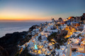 Oia town on Santorini island, Greece at sunset. Famous windmills - PhotoDune Item for Sale