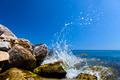 Waves hitting rocks on a tropical beach. Greece, Santorini. - PhotoDune Item for Sale