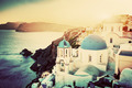Oia town on Santorini island, Greece at sunset. Rocks on Aegean - PhotoDune Item for Sale