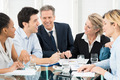 Businesspeople Discussing In Meeting