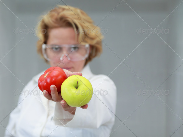 Female Scientist Offering Natural Food - Stock Photo - Images