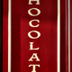 Chocolate Sign on French Store Storefront Display - PhotoDune Item for Sale