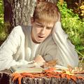 Teenager reading outdoor - PhotoDune Item for Sale