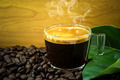 black roasted arabica coffee beans and cup full of coffee - PhotoDune Item for Sale