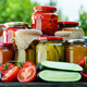 Jars of pickled vegetables in the garden. Marinated food - PhotoDune Item for Sale