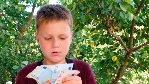 Boy Smelling Euro Notes 1