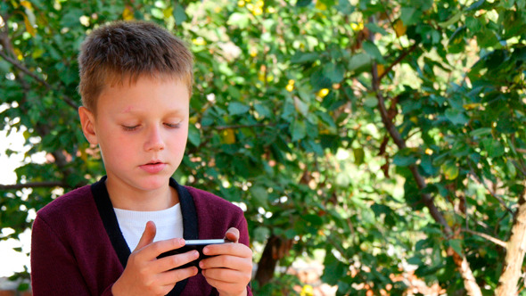 Young Man Communicates On The Smartphone