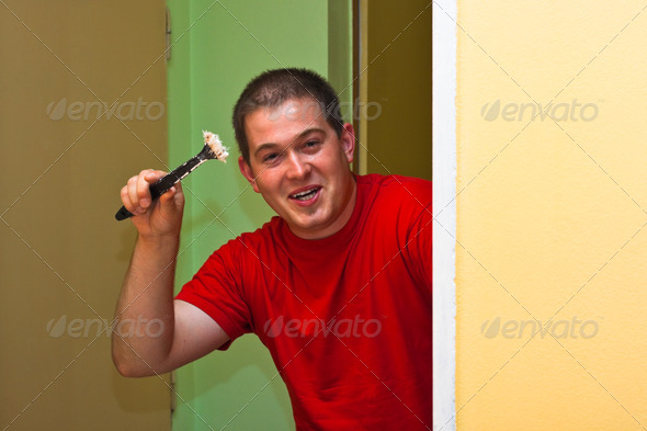 Happy man painting - Stock Photo - Images