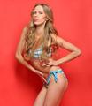 beautiful blonde woman in a striped swimwear. - PhotoDune Item for Sale