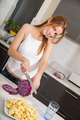 Redhead girl slicing in kitchen telephoning - PhotoDune Item for Sale