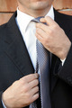 Businessman adjusting necktie - PhotoDune Item for Sale