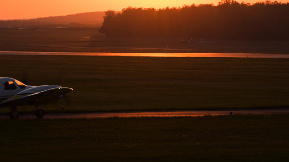 Plane Starting Against Sunset Sky