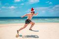 Man in santa hat on the tropical beach - PhotoDune Item for Sale