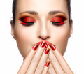Beautiful Girl in Red with Hands on Her Face. Nail Art and Makeu - PhotoDune Item for Sale