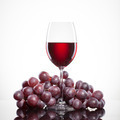 Glass of red wine and grape isolated on white - PhotoDune Item for Sale