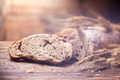Bread and wheat on wooden table, shallow DOF - PhotoDune Item for Sale