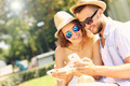 Couple with smartphones in the park - PhotoDune Item for Sale