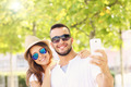 Happy couple taking selfie in the park - PhotoDune Item for Sale