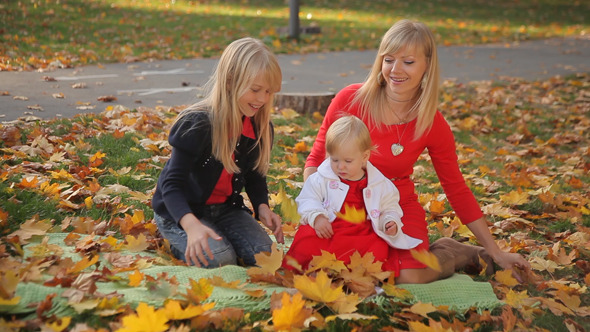 Mom and Two Daughters Playing in the Park