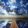 wooden pier on big lake and sky reflection - PhotoDune Item for Sale