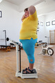 impressed overweight woman on scales in gym - PhotoDune Item for Sale