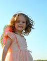 smiling little girl on meadow - PhotoDune Item for Sale
