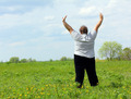 overweight woman with hands up on meadow - PhotoDune Item for Sale