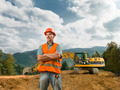 engineer standing on construction site - PhotoDune Item for Sale