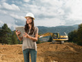 female architect supervising construction - PhotoDune Item for Sale