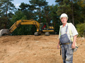 portrait of senior worker on construction site - PhotoDune Item for Sale