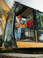 male worker operating excavator - PhotoDune Item for Sale