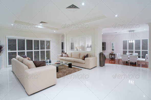 Luxurious living rooms with dining table in the background - Stock Photo - Images