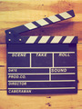clapper board on wood background vintage color tone - PhotoDune Item for Sale