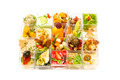 Canapes of cheese vegetables meat and seafood on white background - PhotoDune Item for Sale