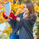 Woman Holding Computer Tablet Outdoors in Autumn - PhotoDune Item for Sale