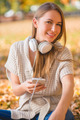 Attractive young woman listening to music - PhotoDune Item for Sale