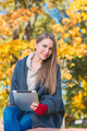 Attractive young woman enjoying an autumn day - PhotoDune Item for Sale