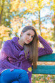 Thoughtful woman relaxing in an autumn park - PhotoDune Item for Sale