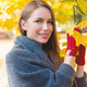 Smiling woman gathering autumn leaves - PhotoDune Item for Sale