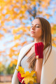 Young woman savoring the beauty of autumn - PhotoDune Item for Sale