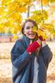 Laughing vivacious woman in an autumn park - PhotoDune Item for Sale