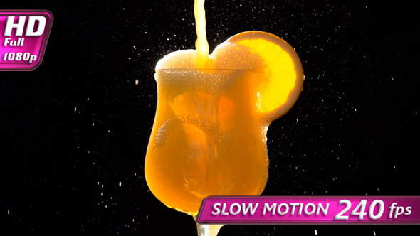 Stream of Orange Juice in a Glass