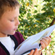 Boy Reading Book In The Park - VideoHive Item for Sale