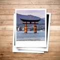 Miyajima Japan memory on photo frame brown wood plank background - PhotoDune Item for Sale