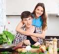 Happy man and  woman cooking food - PhotoDune Item for Sale