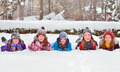 children on snow in winter time
