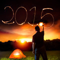 happy new year 2015. young man drawing 2015 by sparkling stick. camping on the mountain - PhotoDune Item for Sale
