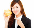 happy businesswoman holding a golden piggy bank .isolated on a white background - PhotoDune Item for Sale