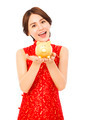 asian young woman holding a golden piggy bank . happy chinese new year - PhotoDune Item for Sale