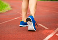 runner feet running on track and closeup of shoe. workout wellness concept - PhotoDune Item for Sale